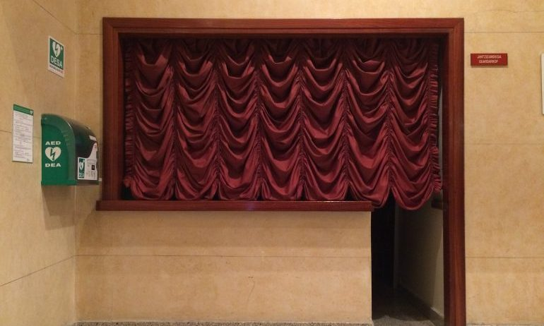 A curtain drawn over a counter