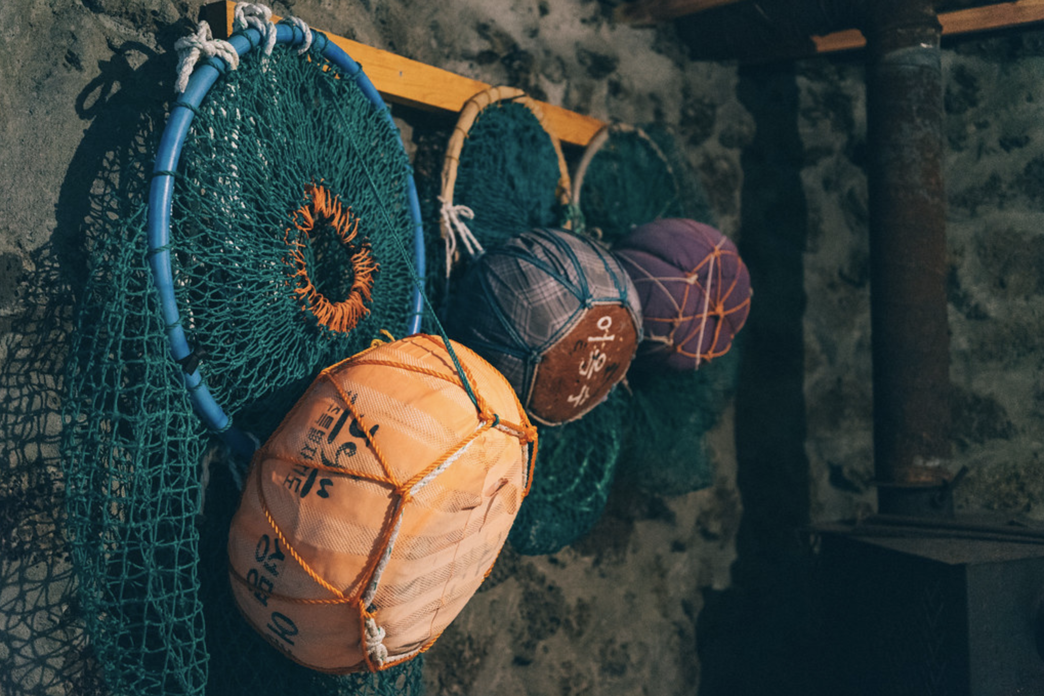 Tools used in Haenyeo diving are hung on a rack.