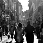 Black and white people walking through a city.