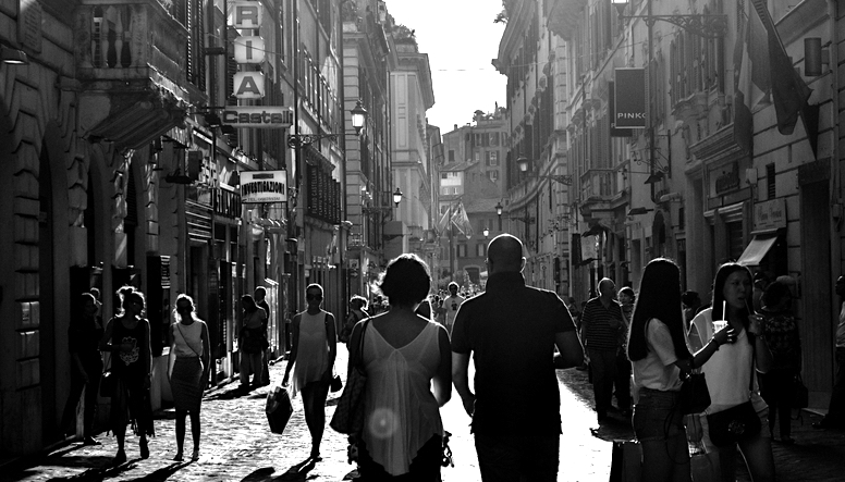People walking through streets. Black and white.