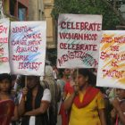 A photograph of women in India holding signs about menstrual hygiene