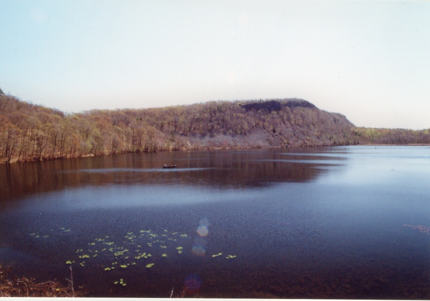 A photograph of a pond and a small mountain