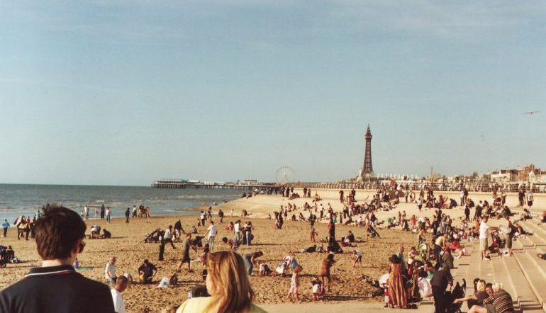 Vintage photo of a full beach on the coast of Britain