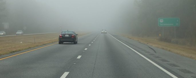 a photograph of a car driving down I-10 in Florida