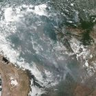 a satellite image of smoke and fires in the Brazilian rainforest