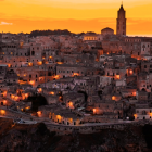 a photograph of an old Italian city at sunset