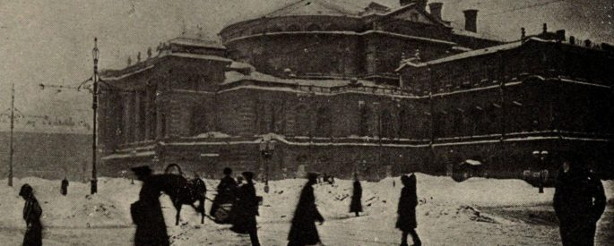 a black and white photograph of a Russian theatre in winter with people walking around