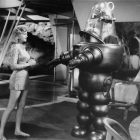 black and white photo of a woman and a robot