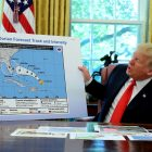 Donald Trump holds up a map of the trajectory of hurricane Dorian
