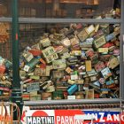 photo of clutter in an antique or junk store--it is a pile of things against the storefront window
